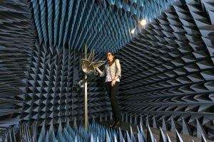 person in electromagnetic RF anechoic chamber with quad ridged horn antenna